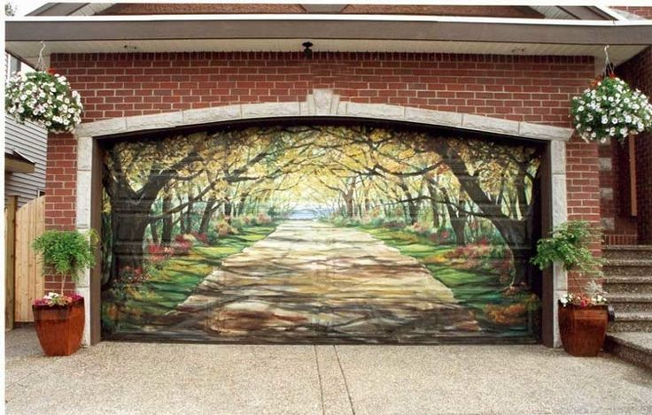 Coolest garage door ever! If I were an artist I would offer this as an option when we sell our doors.