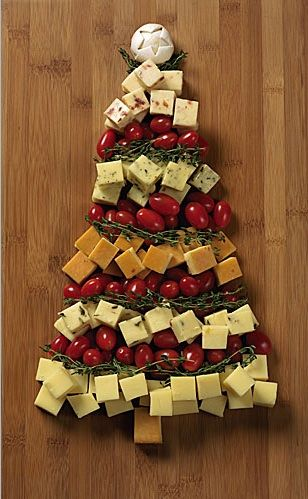 5 (8-ounce) bars Cabot Sharp Cheddar, plain and flavored  Fresh thyme sprigs  Grape cherry tomatoes or olives  1 mushroom  Directions:  1. Cut each bar of cheddar into 1-inch cubes.    2. On large platter or cutting board, arrange cubes in rows to form tree shape, using different flavor for each row and separating flavors with thyme sprigs and rows of tomatoes or olives.    3. For star on top, peel skin from mushroom; press star pattern into mushroom with point of knife.