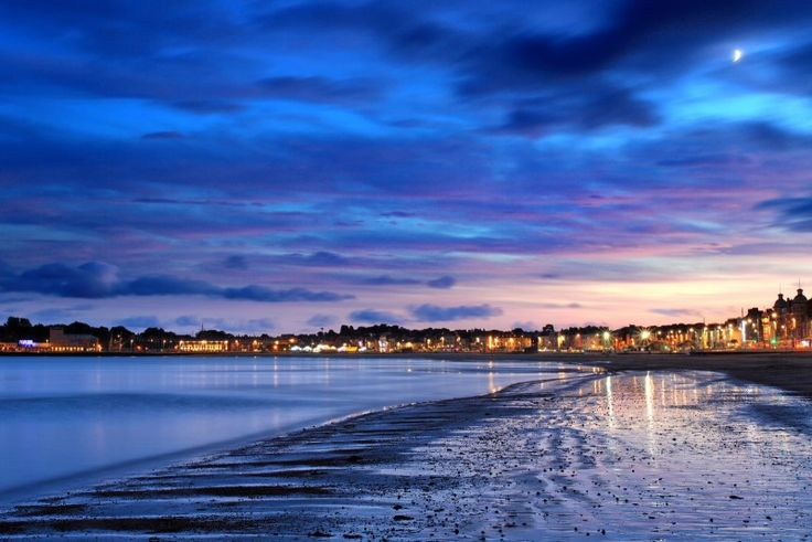 Weymouth beach, in Dorset, at sunset, during December