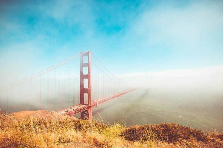 Colorful Golden Gate Bridge in Foggy But Sunny Weather Free Stock Photo