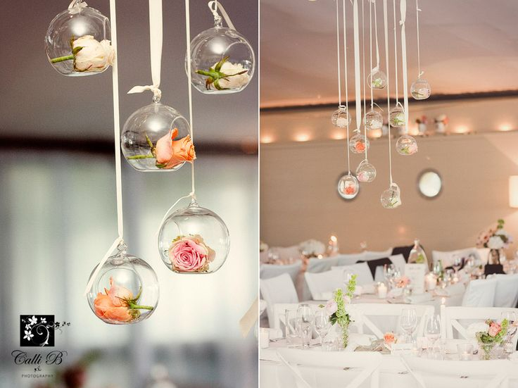 Sails restaurant Noosa! Hanging baubles with single rose heads in pastel colours. Image by Calli B photography