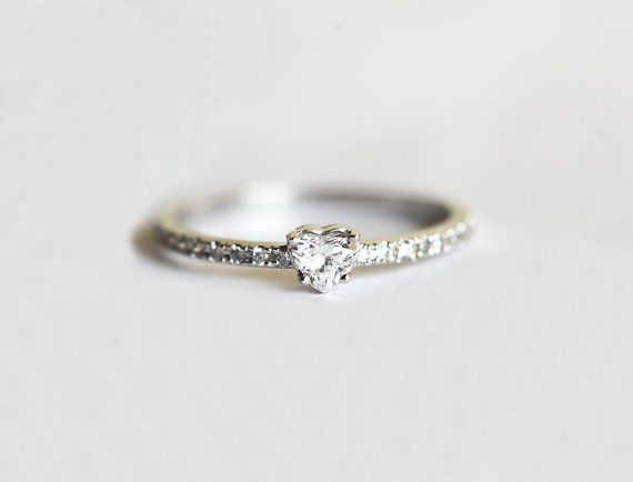 Feminine and sparkly heart diamond ring with pave side diamonds. Product info: Gemstone: Heart diamond Gemstone Weight: 0.17ct Gemstone Quality: Color