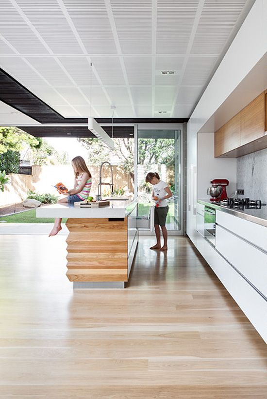 indoor/outdoor. clean lines white kitchen