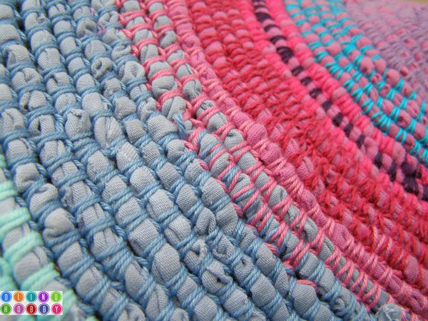 Crocheted rug using old t-shirts and yarn [blog in Russian but the pictures make the process clear enough] -- I love the flat look of it and the colours are yum too!