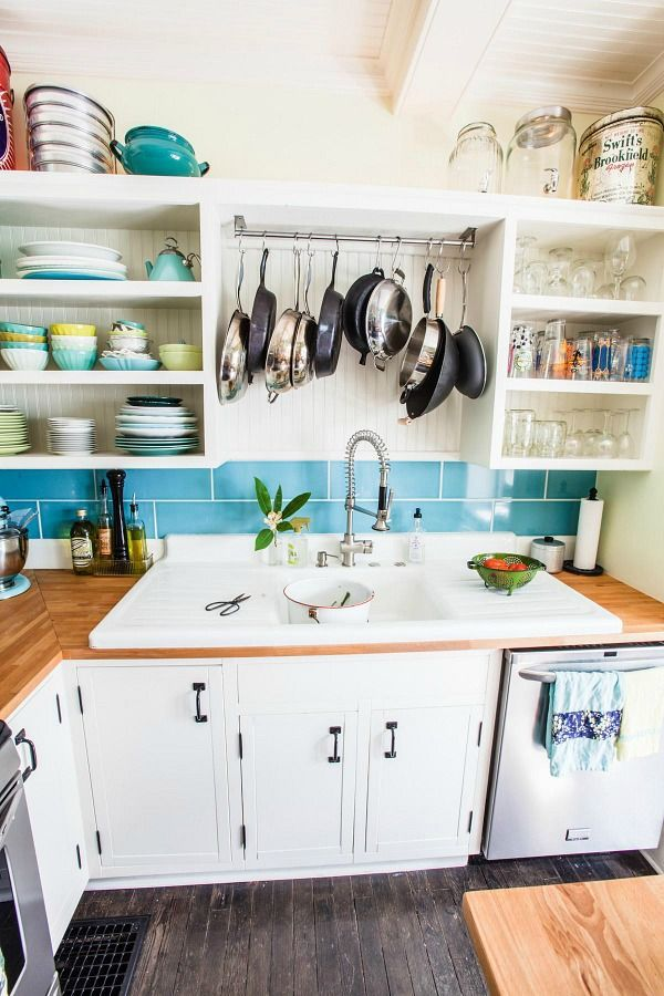 This idea is a two-for-one: not only does this use up wasted space above your sink, but it also serves as a drying rack for pots and pans. Hang and let them drip dry after you wash them.