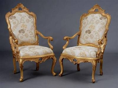 Pair of very fine, Venetian, Rococo period tall-back armchairs: Each cartouche-shaped backrest with pierced foliate carved top rail, the downswept scrolled armrests, above the serpentine-fronted seat above a pierced apron, raised on cabriole legs with scrolled toes; upholstered à chassis. Circa 1730. Regilt.