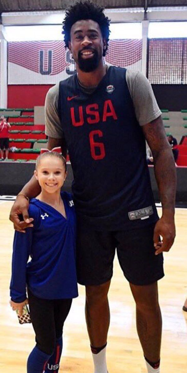 D'Andre Jordan with Women's Gymnastics team member (alternate) Ragan Smith.