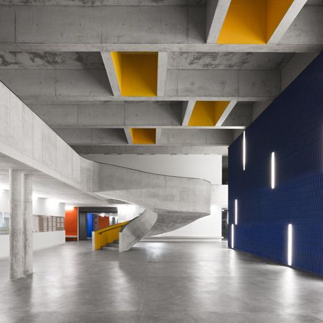 Bold primary colours punctuate this stark concrete extension to a secondary school outside Lisbon by Portugese architect CVDB Arquitectos (+ slideshow)    http://www.dezeen.com/2013/02/07/braamcamp-freire-secondary-school-by-cvdb-arquitectos/