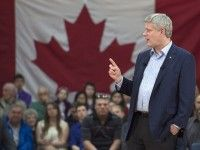 Prime Minister Stephen Harper addresses supporters in a campaign-style visit to the riding of Cumberland-Colchester to support incumbent Conservative MP Scott Armstrong, in Truro, N.S. on Thursday, May 14, 2015. THE CANADIAN PRESS/Andrew Vaughan