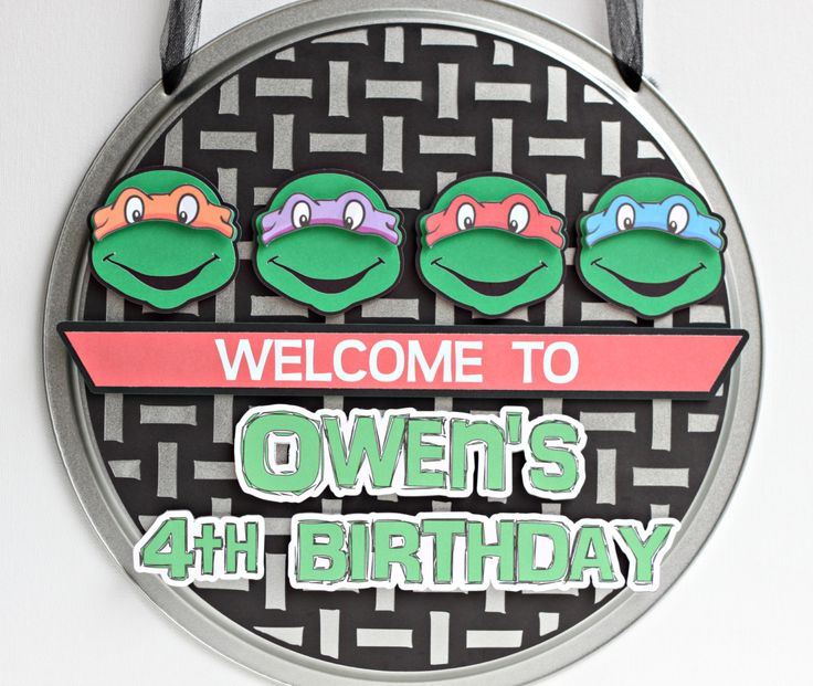 Teenage Mutant Ninja Turtle door sign made from an actual pizza pan! Perfect to welcome your guests to your SHELL-A-BRATION!