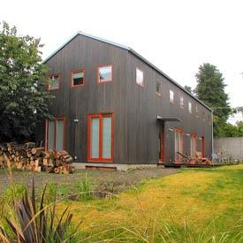 farm house dark warm grey with red trim