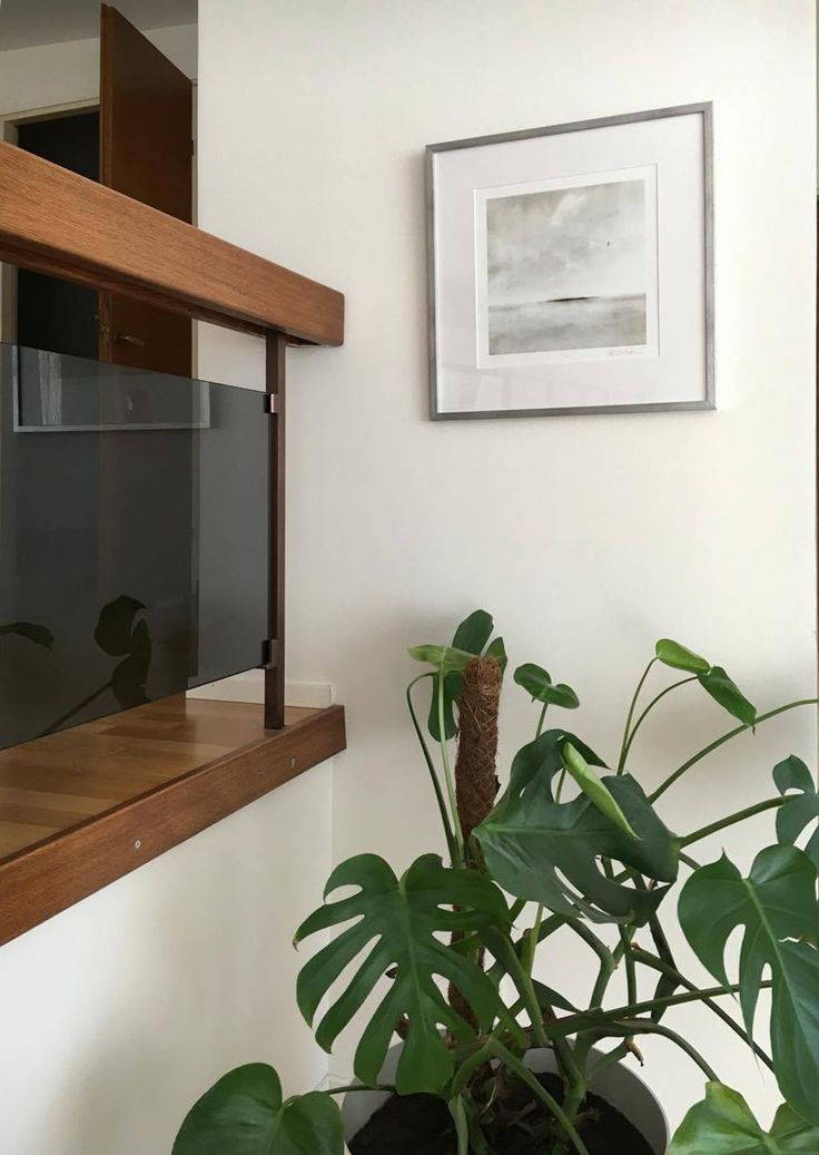 Päivi Hintsanen: 'Arrival' framed on wooden 'brushed steel' painted frame, in lightful, beautiful surroundings. Photo by Anna G.