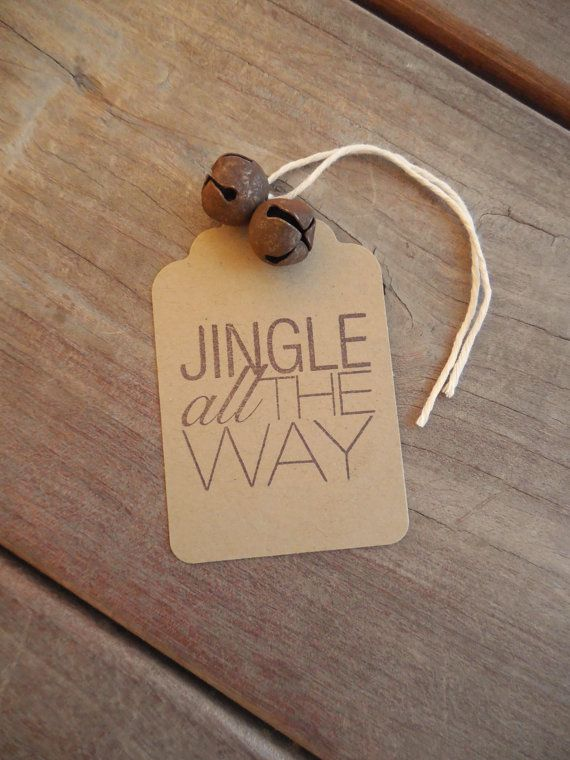 Spread a little Christmas cheer with these festive tags!    Kraft paper tags have been hand stamped with Jingle All the Way in dark brown