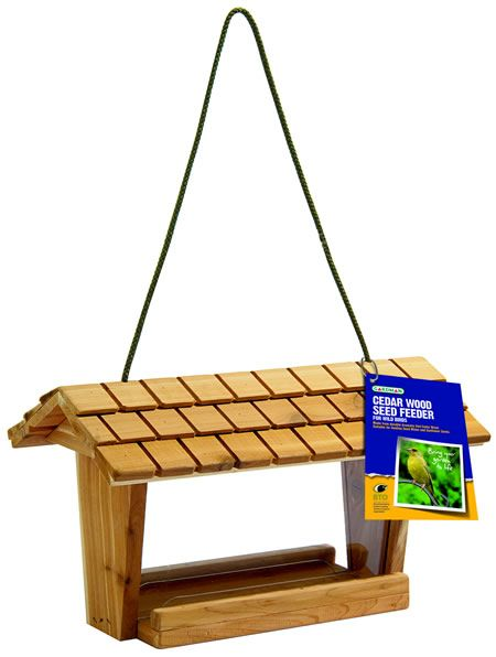 This new attractive #seed #feeder is made from aromatic red cedar with a tile effect roof.  The polycarbonate panes, which are easily removable, create a chamber to contain your seed mix.  It has two ledges to allow multiple feeding. - See more at: http://www.reallywildbirdfood.co.uk/peanuts-and-niger-seed/seed-feeders/cedar-wood-seed-feeder-4-17-P490/