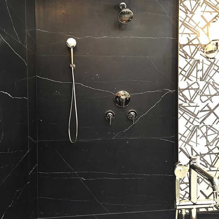 Black marble shower combined with black and white graphic tiles ...... I want…