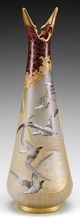 ROYAL FLEMISH FLYING SEAGULL VASE. Satin finished vase is decorated with flying seagulls, a sunset and an art nouveau floral decoration at unusual neck. The colors used in this vase are deep cranberry, gold and realistic hues on the flying geese.