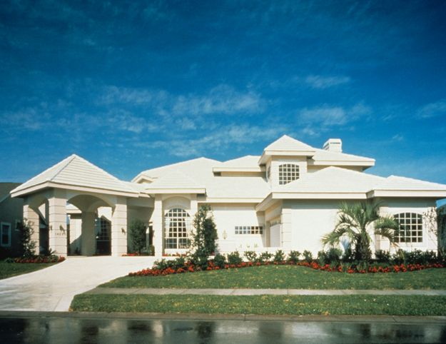 Corner quoins heighten the elegance of this home porte for Porte cochere home plans