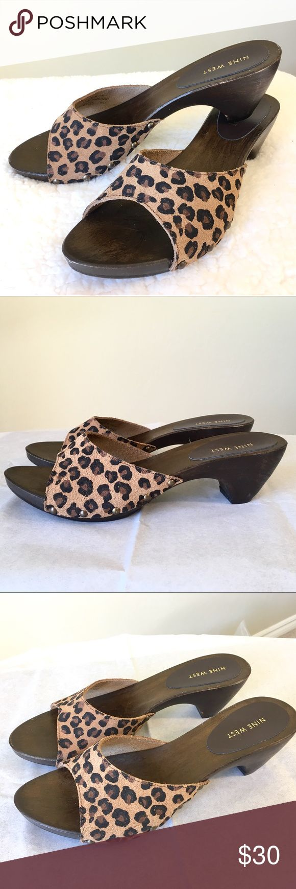 Nine West Leopard Sandals Size 9 New but No Box Nine West Leopard Sandals Size 9 New but No Box. I only tried them on wearing around the house. Please note there are scratches on the side of the wooden sole and the side of the heel (See last photo) Nine West Shoes Sandals