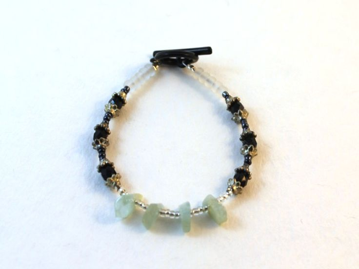 This is such a cute little bracelet. I love the green chip beads.