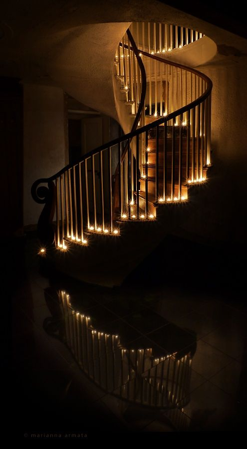 spiral staircase lit only by candle light
