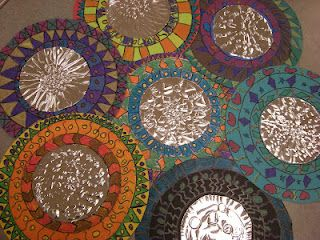 3rd Grade Mexican Folk Art Mirrors: tooling foil circle glued in center of colored paper circle. Radial design lesson.