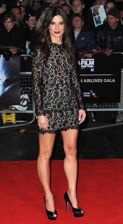 "Sandra Bullock: Wearing a lace Stella McCartney mini and Charlotte Olympia platform peep-toes to the London Film Festival premiere of ""Gravity"""