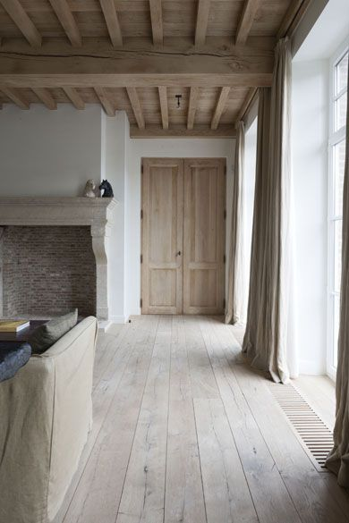 white-washed, rustic wood flooring and ceiling