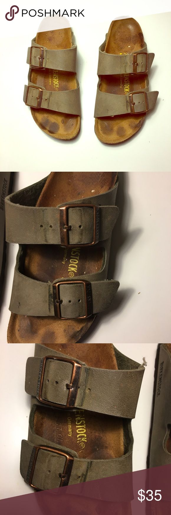 Birkenstocks in Arizona Style in Brown Brown Arizona Birkenstock sandals. Well loved, but lots of life left. Light brown bands, bronze buckets and details. Foot staining in sole as shown and some wear in heels. Birkenstock Shoes Sandals