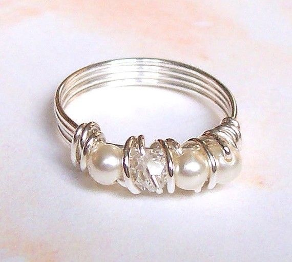 "DIY ring. Easy to make- sterling silver ring or rings, ""pearls"" or any other beads or stones, and thicker craft wire.."