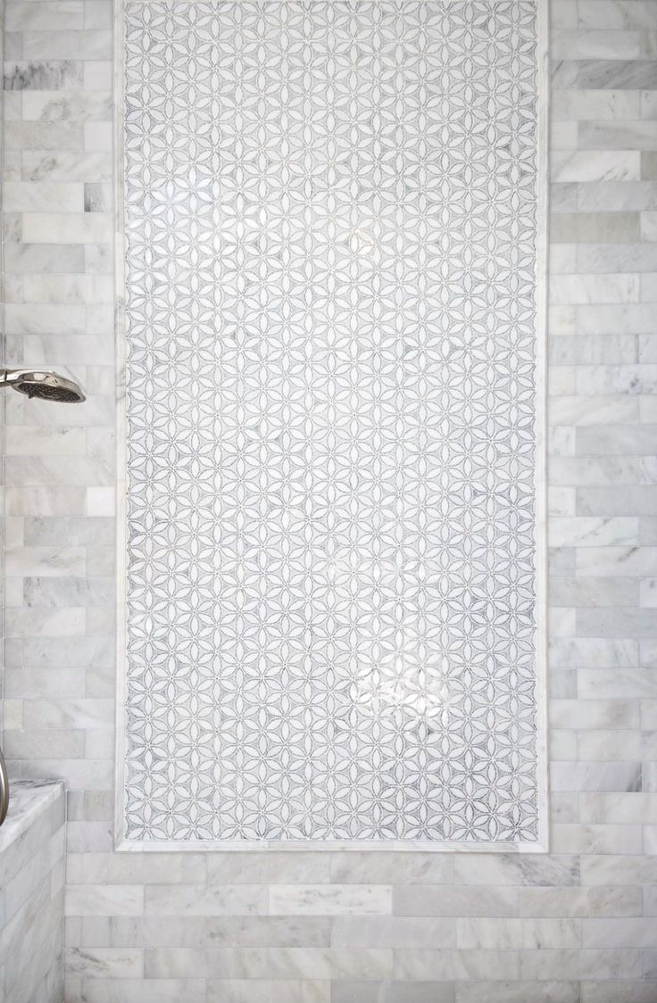 Artistic Tile IIn the bath, our 'Shiraz' mosaic creates an elegant runner in Calacatta Gold and Thassos marble, complementing the shower's art-like 'Flapper Floral' panel, cut from Be Bop White Jazz Glass. The panel is framed and surrounded by Thassos and Calacatta Gold field tile in an offset brick pattern, for a classically elegant backdrop I Designer: AB Design Elements, LLC. I Dealer: Craftsman Court Ceramics I Photos by: Jack London I Artistic Tile Sales Rep:Ernesto Diaz
