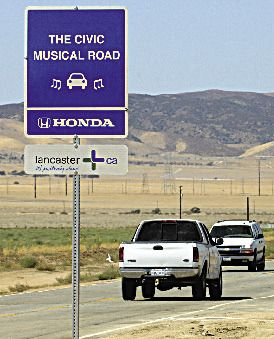"""The Honda Civic Musical Road: Originally created for a Honda commercial in 2008, strategically placed grooves that, when driven over, produce the musical notes to the finale of Rossini's """"William Tell Overture."""" stay in the far left lane of the three-lane road. Lancaster, CA"""