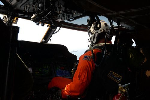 OAK HARBOR, Wash. (June 13, 2014) Lt. Cmdr. Shane Jones, from Toledo, Ohio, assigned to Naval Air Station Whidbey Island's Search and Rescue unit, pilots an MH-60S Knighthawk above the aircraft carrier USS Nimitz (CVN 68) in the Strait of Juan de Fuca. Nimitz is underway hosting friends and family day, an event where nearly 400 civilian guests joined the ship's crew for a special one-day underway. (U.S. Navy photo by Mass Communication Specialist 2nd Class John Hetherington)