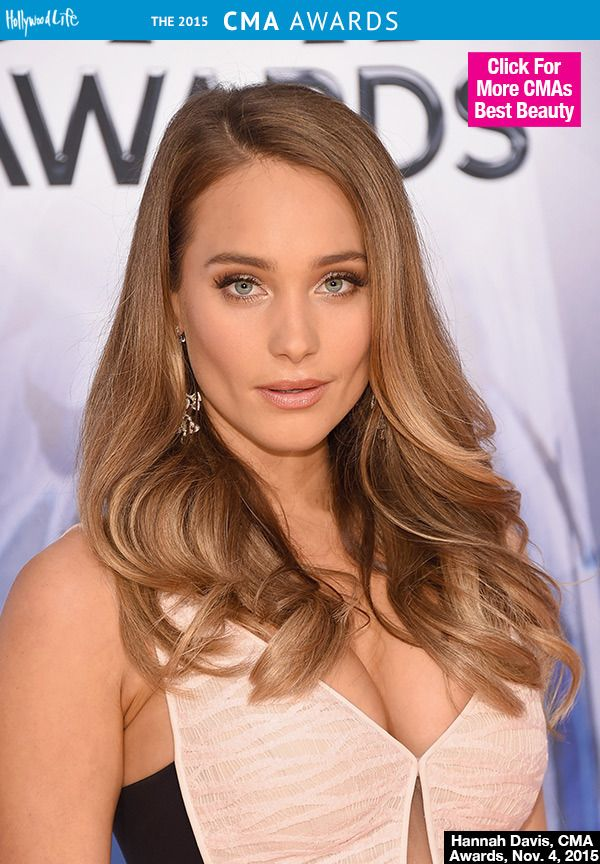 Hannah Davis attended the 2015 CMA Awards in a gorgeous blush dress with soft rose gold makeup to match. The newly engaged model looked stunning with golden skin, soft bronze eye makeup and matching lip. Get her exact look, below! | Shop HD's mark. #lipstick here: http://avon4.me/1k5zoMF