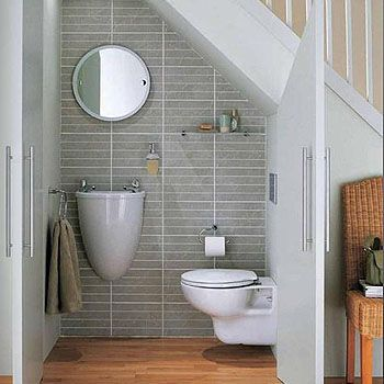 No main floor bathroom in a small house?  No problem - neat solution for a compact bathroom.