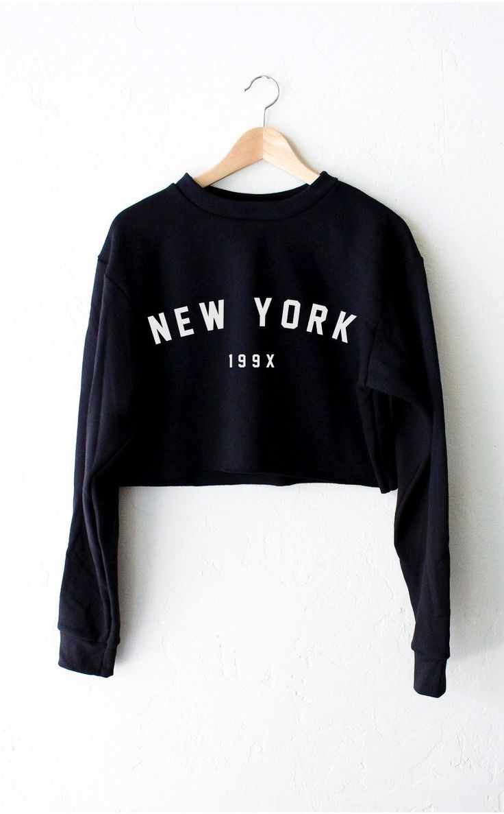 """- Description - Size Guide Details: Super cute & soft oversized cropped sweater in black with print featuring 'New York 199x'. Brand: NYCT Clothing. 50% Cotton, 50% Polyester. Made in USA. Sizing: 40"""""""