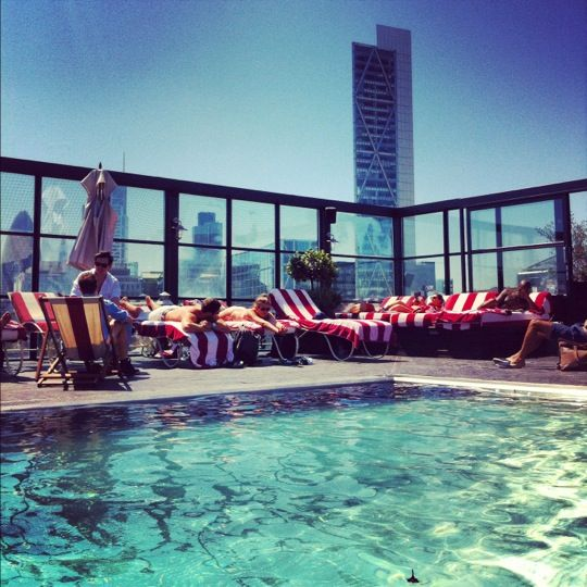 Take a dip in the rooftop pool at Shoreditch House - the perfect way to cool off on a hot day.