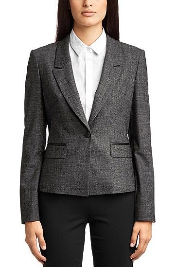 She wore a new ensemble from BOSS Hugo Boss. She has now added the 'Jetala' blazer and matching 'Taru' trouser to her every growing collection of Hugo Boss suits. The jacket and pants are made of a new wool blend with elastane in a mottled pattern. The one-button blazer has a peak lapel and two piped pockets with tucked-down flaps. The blazer and two waist darts in the front and three panel seams in the back for a slim-fit. It retails for £380.