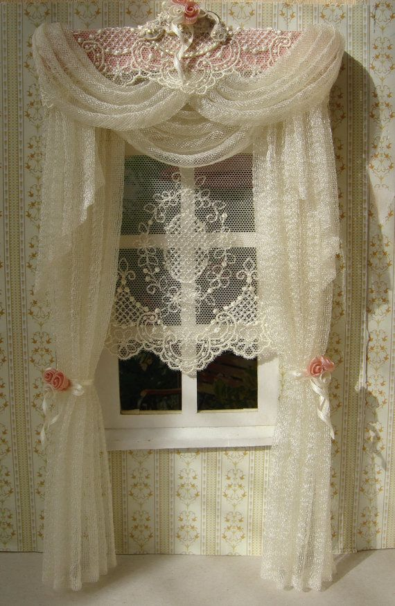 The curtains measure 11,5cm wide x 21 cm height. Pelmet is made of carton and covered with the fabric and lace.