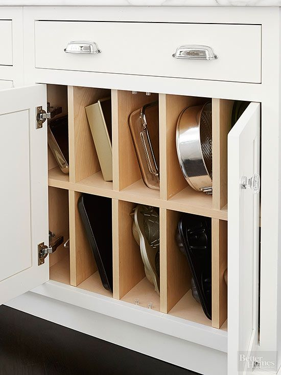 The homeowners of this kitchen love to bake, so having space for all their cooking and baking supplies was a must. Cabinet dividers that keep bakeware upright make it easy to select the right pan for the task at hand. /