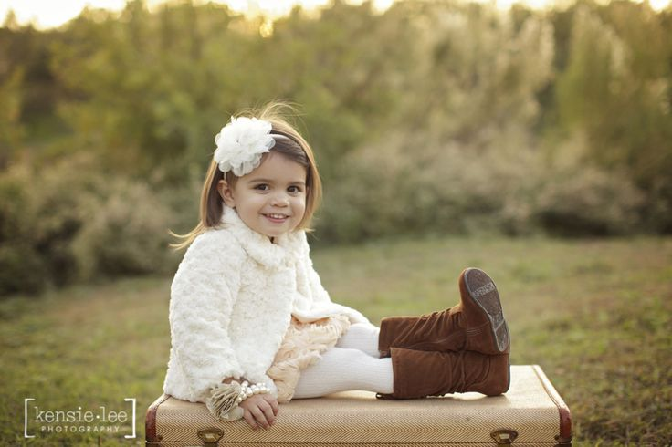 Paislee is not only the most adorable little girl in San Angelo, she is also very well mannered!!! I have never heard so many kind thank you's and yes ma'am's in a session. She sat, she posed, she laughed... She was a perfect little doll. We started the session on some old vintage props: tweed…