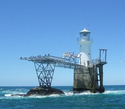 Lighthouses of S.A. Roman Rock is built on a rock just off False Bay, S.A. It has a helipad as boat landings are not always possible in the rough Cape waters.