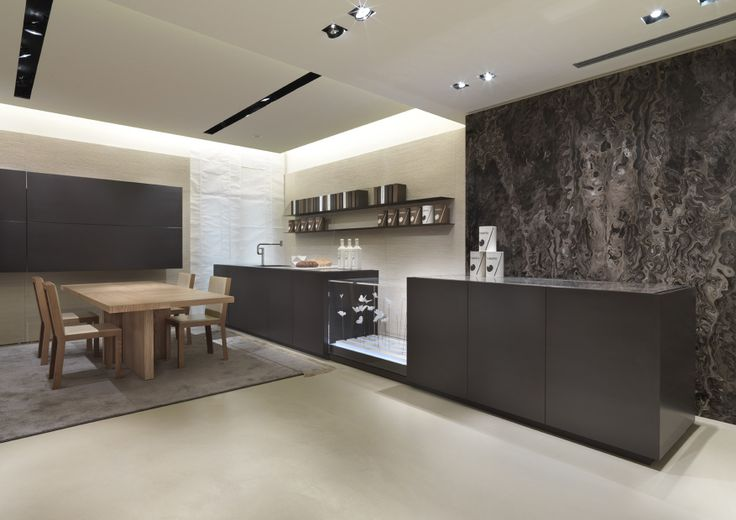 "The project of the Bellagio kitchen by Bartoli design meets new requirements and completes our ""Decor"" system of furniture items such as doors, wall panels, cabinets; a unique proposal for flexibility, for the quality of its materials and the surface design."