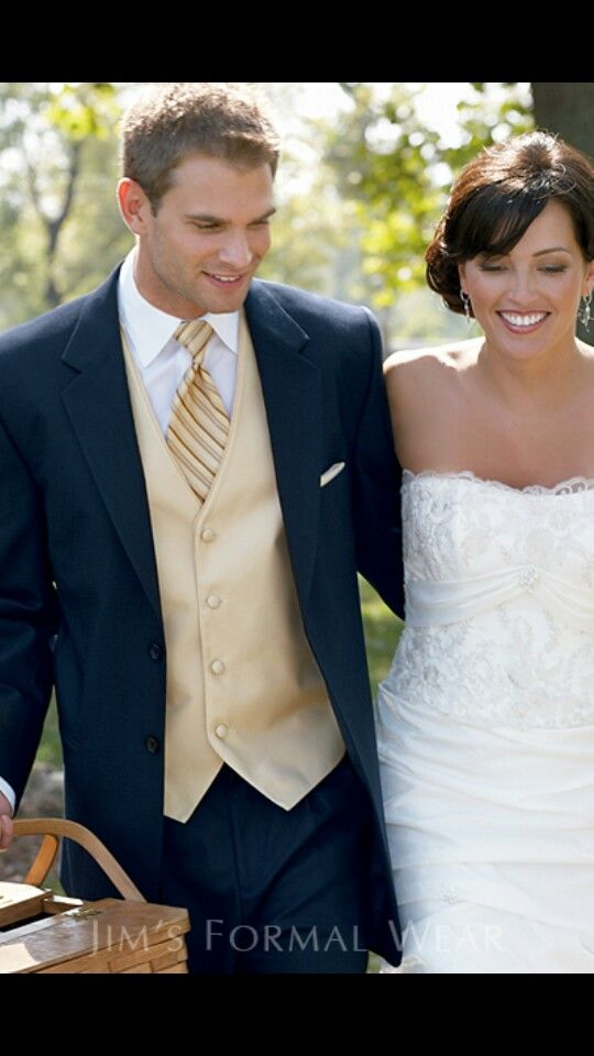 Navy blue tux with a gold vest could be an option for the groom to differentiate him from the groomsmen.