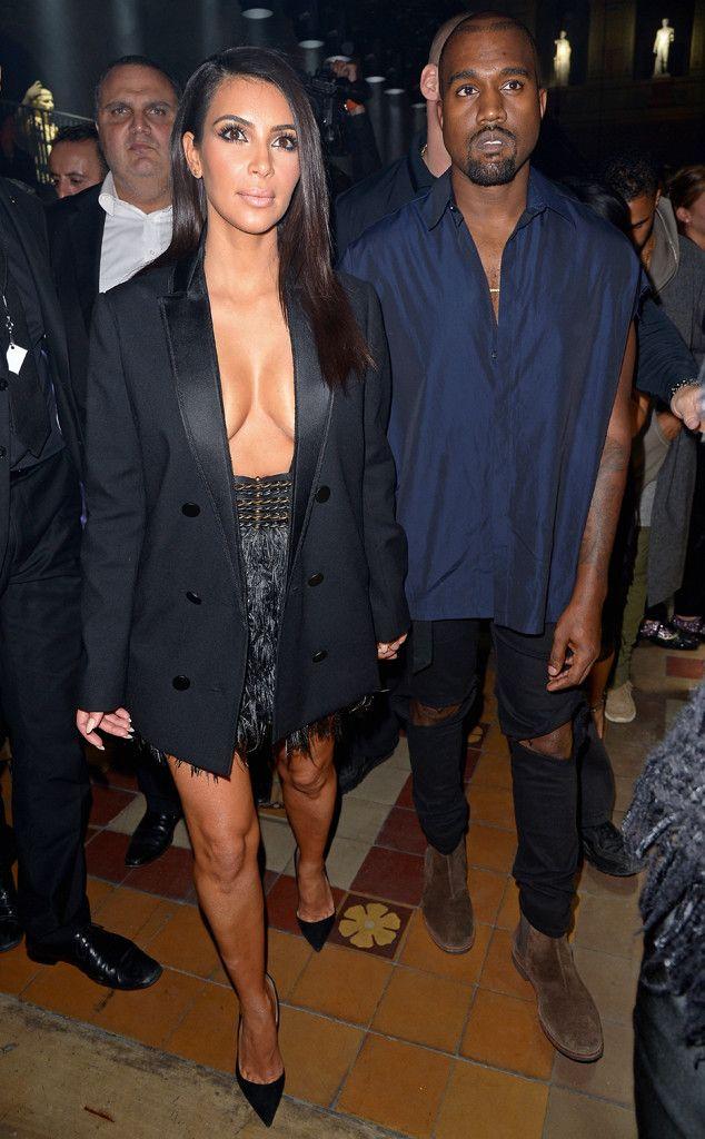 Kim Kardashian Flashes Major Cleavage (and Kanye West Does Too!) During Paris Fashion Week  Kim Kardashian, Kanye West
