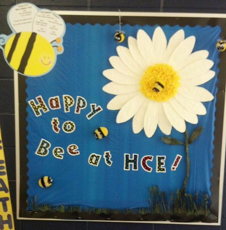 Our back to school PTO bulletin board at an elementary school. All the important dates are on the bees wings on the top left. The other bees are either glued to the board or hanging from wire.