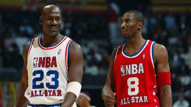 Flashback - Michael Jordan (Washington Wizards) #23 of the Eastern Conference All-Stars talks with Kobe Bryant (Los Angeles Lakers) #8 of the Western Conference All-Stars at the 2003 NBA All-Star Game on February 9, 2003 at Philips Arena in Atlanta, Georgia.