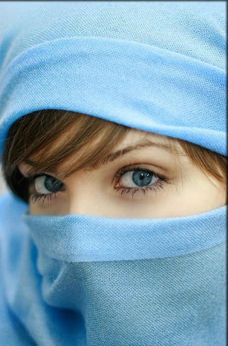 Looking out of a blue scarf.