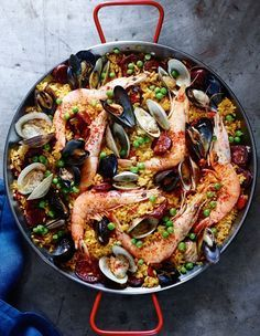Spanish Paella with Chorizo and Seafood | Chock-full of three kinds of seafood plus spicy chorizo, this Spanish paella will satisfy a hungry crowd. The recipe calls for Bomba rice, a short-grain Spanish rice that is prized for its ability to absorb almost three times its volume in liquid, while the grains still remain firm and delicious, but any sort of Spanish paella rice will do.