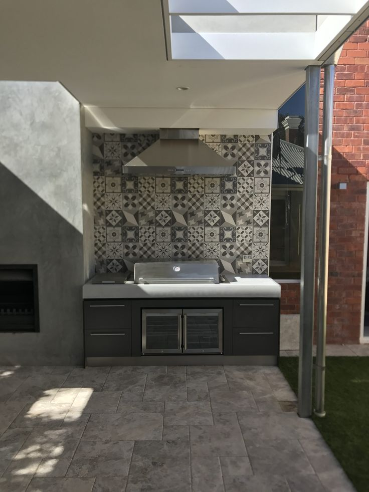 Outdoor Kitchen with Beefeater appliances and polished concrete benchtop from Concrete Studio
