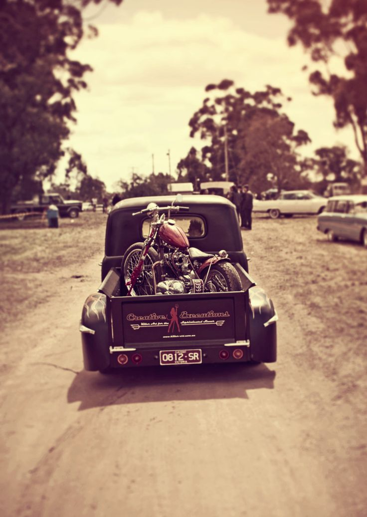 Dream, old pick up with the classy patina and a harley sportster tucked in the back.